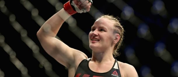 Valentina Shevchenko wins and raises her hand after a UFC fight