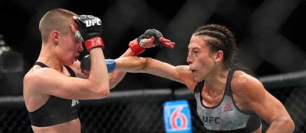 Joanna Jedrzejczyk leads with a right hand against Rose Namajunas