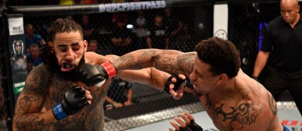 Greg Hardy lands a KO punch on his opponent in the UFC