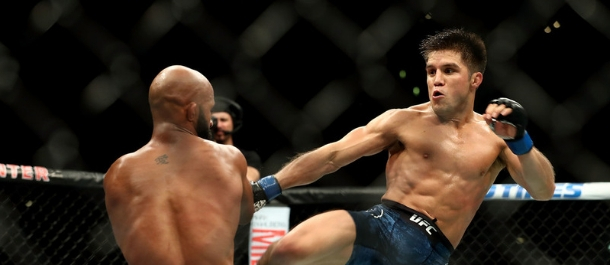 Henry Cejudo kicks Demetious Johnson in UFC title fight