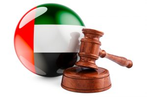 Wooden gavel with flag of the UAE