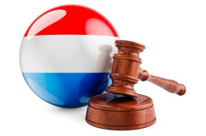 Wooden gavel with flag of Luxembourg